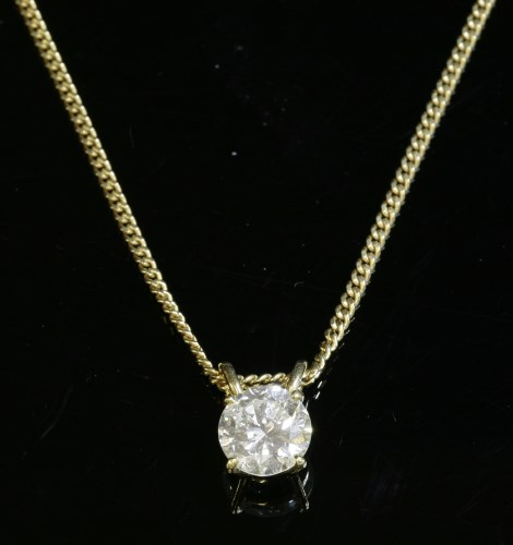 304 - An 18ct gold single stone diamond pendant