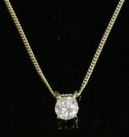 304 - An 18ct gold single stone diamond pendant