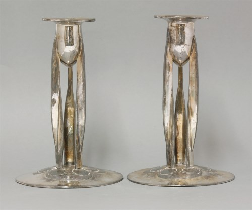 192 - A pair of plated Tudric candlesticks