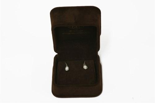 Lot 23-A pair of white gold single stone diamond earrings