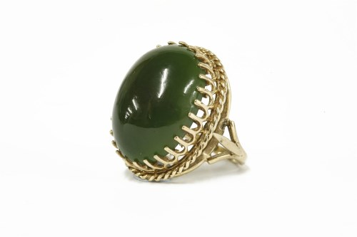 Lot 20-A 9ct gold single stone oval nephrite cabochon ring 12.29g