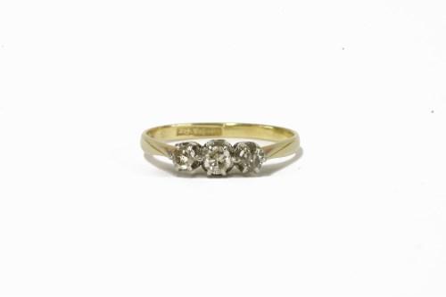 Lot 6-A gold three stone diamond ring