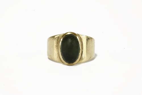 Lot 5-A gold single stone tourmaline cabochon ring (tested as approximately 9ct) c.1960