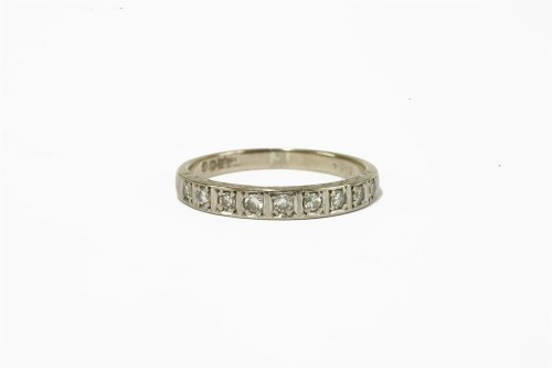 Lot 2-A white gold diamond half eternity ring