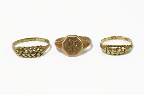 Lot 15-A 9ct gold gentleman's signet ring with engraved octagonal head