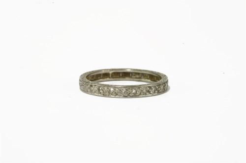 Lot 24-A white gold half hoop diamond eternity ring