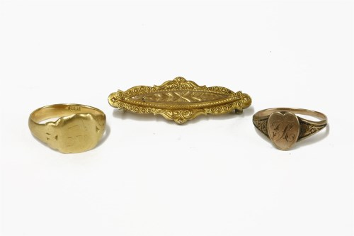 Lot 17-A Victorian 9ct gold brooch with raised engraved boss to centre