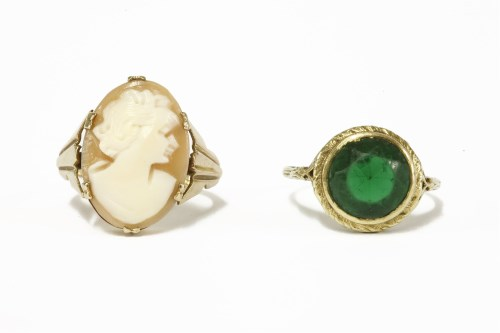 Lot 11-An American gold single stone green paste ring marked 14k