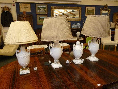 Lot 390-A pair of blanc de chine porcelain table lamps