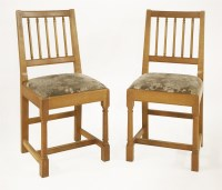 Lot 49-A Peter Hall and Son of Cumbria oak dining room suite