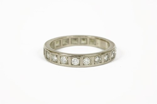 Lot 1011-A white gold diamond half eternity ring