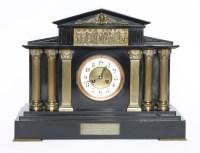 Lot 121 - An Edwardian black marble mantel clock