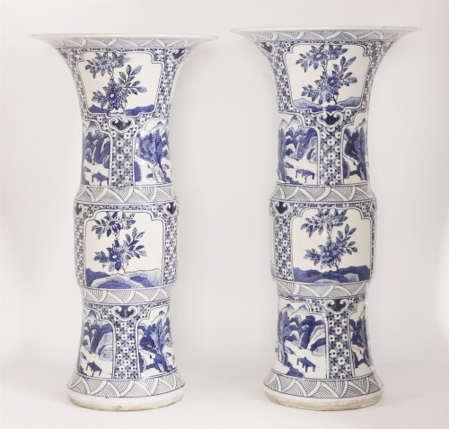 Lot 9 - A pair of Chinese export ware blue and white gu form vases