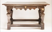 Lot 84 - A Continental oak serving table