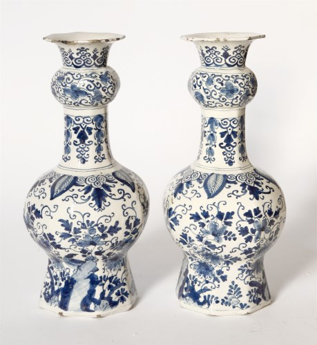 Lot 76 - A pair of delft blue and white vases