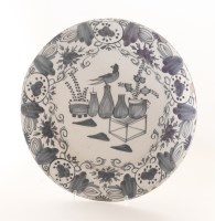 Lot 78 - A Dutch delft blue and white wall plate