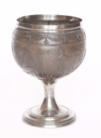 Lot 81 - A silver-mounted stemmed coconut cup