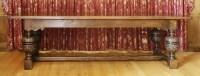 Lot 105 - An oak three-plank refectory table