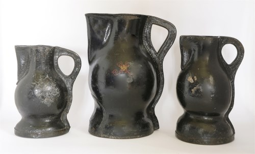 Lot 103-A matched set of three graduated 'Black Jack' leather jugs