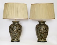 Lot 98 - A pair of decorative black-glazed and gilt-decorated pottery vase-shaped electric lamp bases