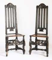 Lot 171 - A pair of Continental oak and walnut high back single chairs