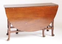 Lot 185 - An oval mahogany drop-leaf table