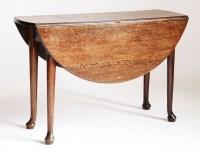 Lot 187 - An oval oak drop-leaf table