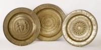 Lot 181 - Three embossed brass Nuremberg alms dishes