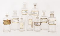 Lot 196 - A collection of nine glass apothecary's jars and stoppers