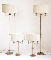 Lot 200 - A set of four slender brass lamp standards