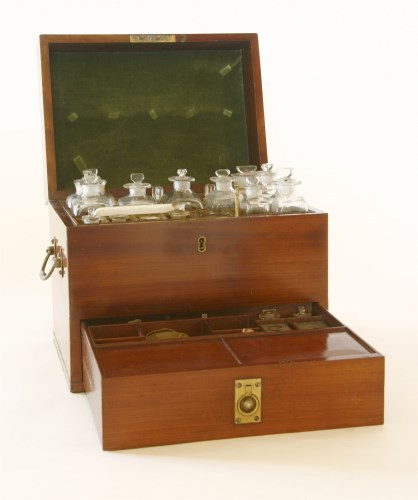 Lot 23 - A George III mahogany apothecary's cabinet