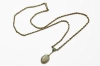 Lot 1039-An Edwardian gold milligrain set oval cut opal drop pendant