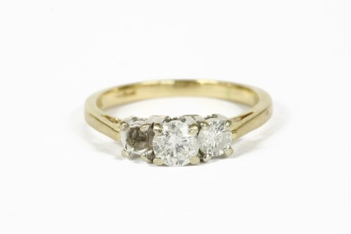 Lot 1015-An 18ct gold three stone diamond ring