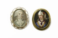 Lot 1043-A painted miniature portrait of a 19th century gentleman in a gold brooch mount (tested as approximately 9ct gold)
