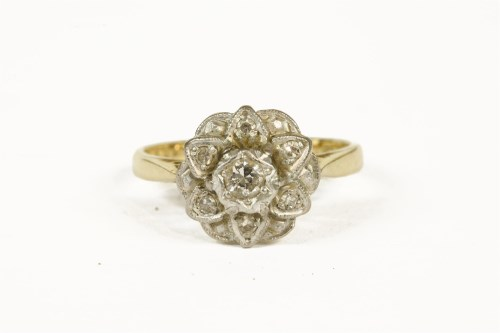 Lot 1005-A gold diamond cluster ring