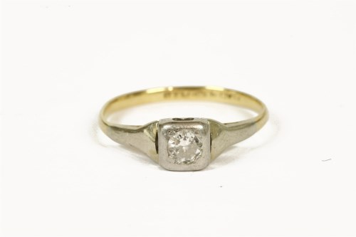 Lot 1006-A gold single stone diamond ring