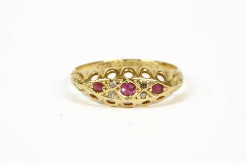 Lot 1016-An 18ct gold ruby and diamond boat shaped ring