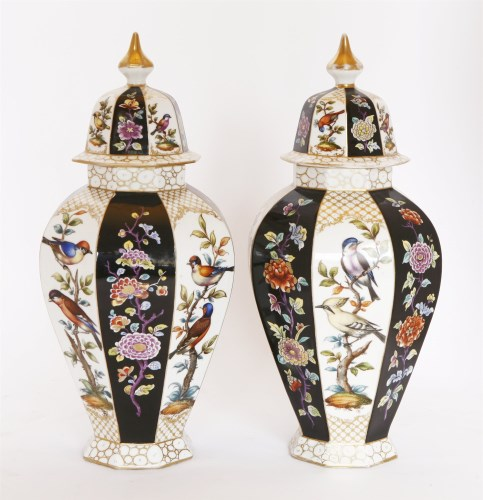 Lot 30 - A pair of Meissen-style vases and covers