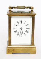 Lot 32 - A brass carriage clock
