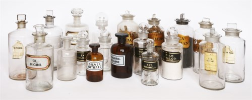 Lot 35 - A collection of glass drug jars and stoppers