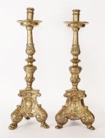 Lot 8 - A pair of heavy cast brass candlesticks