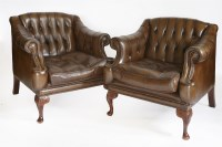 Lot 51 - A pair of modern brown leather armchairs