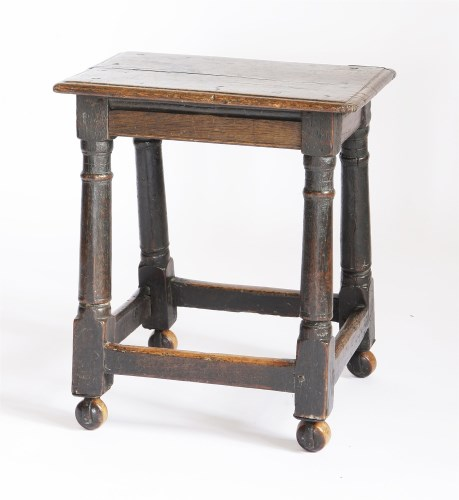 Lot 57 - An oak joined stool