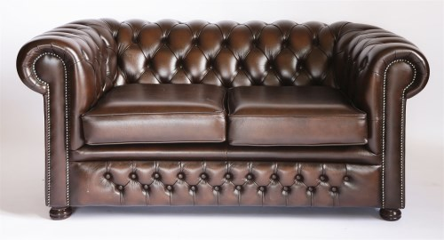 Lot 53 - A modern brown leather two-seat chesterfield settee