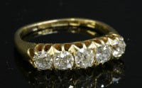 Lot 69-An Edwardian gold graduated five stone diamond ring
