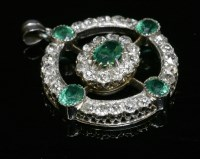 Lot 79 - A late Victorian emerald and diamond circular target-style pendant