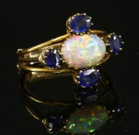 Lot 66-An Edwardian opal and doublet cinquefoil cluster ring