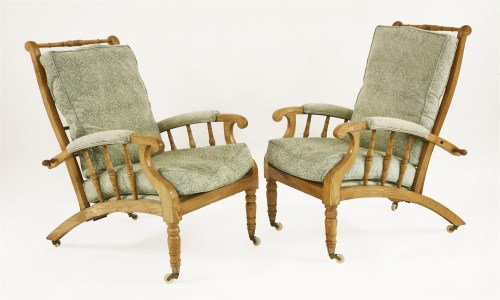 Lot 1-A pair of oak reclining armchairs