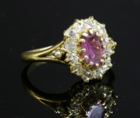 Lot 50A - A ruby and diamond cluster ring