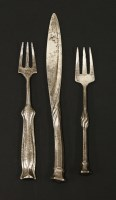 Lot 7-An Arts & Crafts silver butter knife and matching pickle fork
